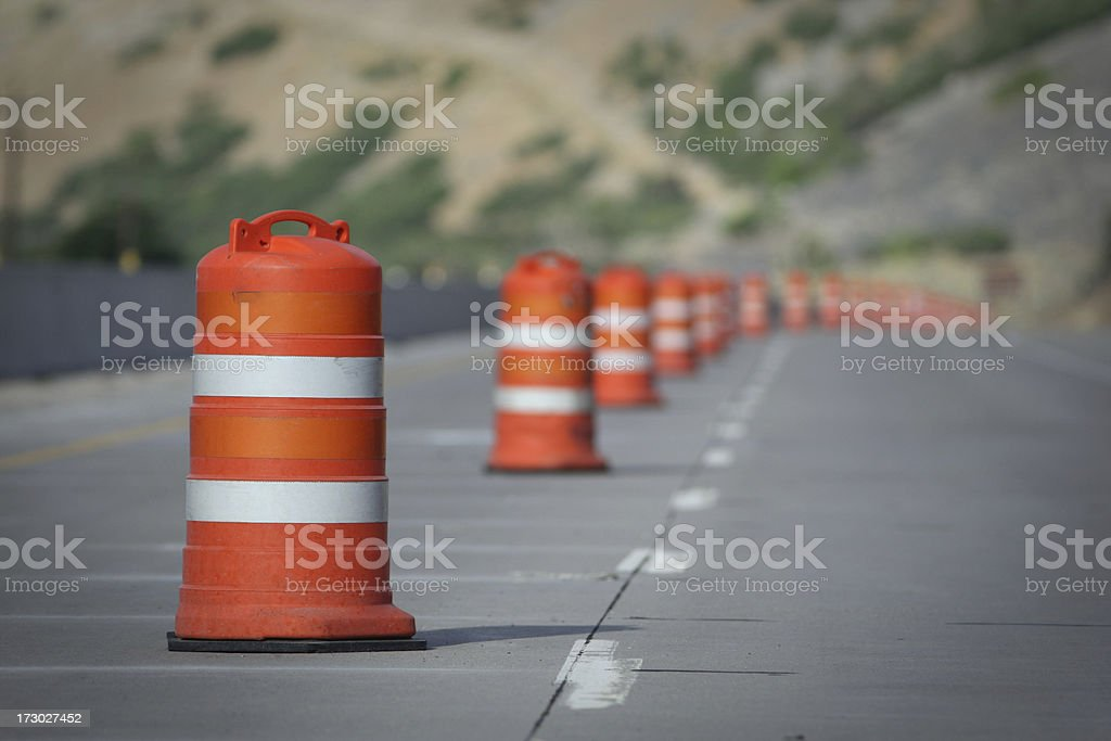 Orange and white construction cones closing a road Lane stock photo