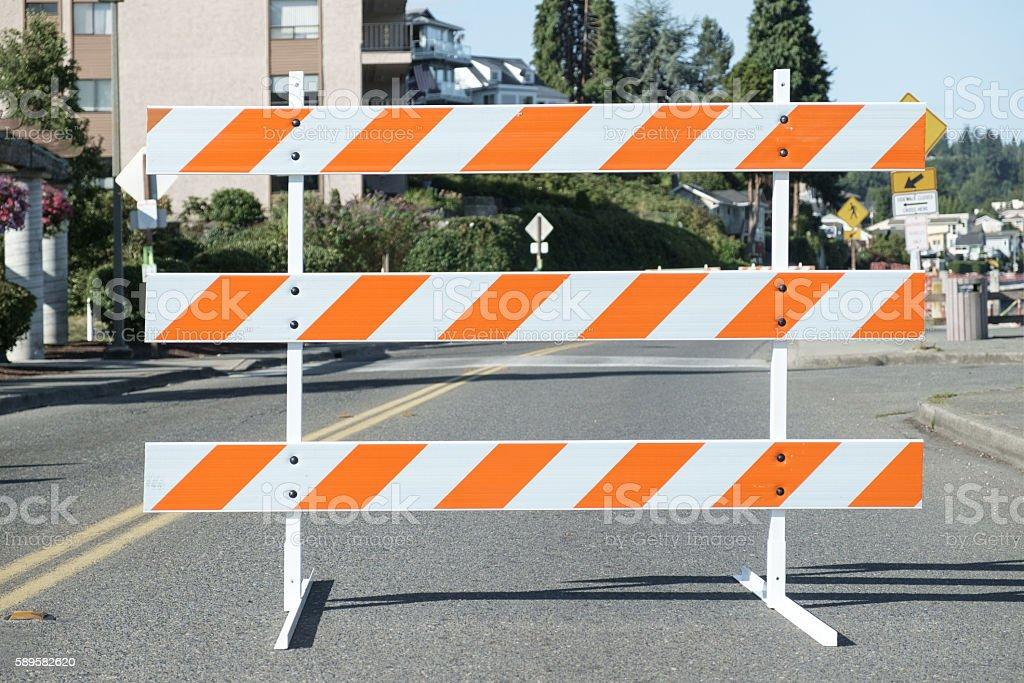 Orange and white road barricade stock photo