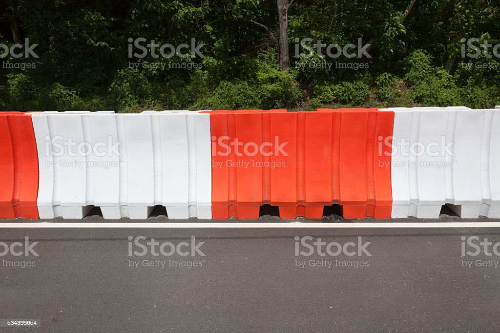 Orange and White Road Barriers stock photo