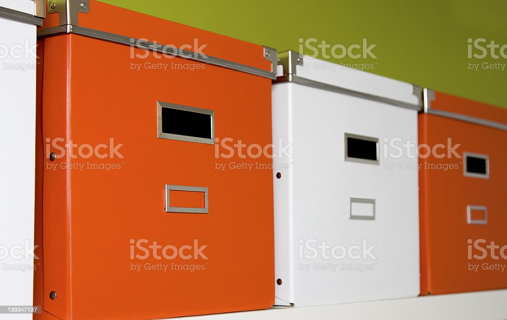 Orange and white storage containers in a row royalty-free stock photo