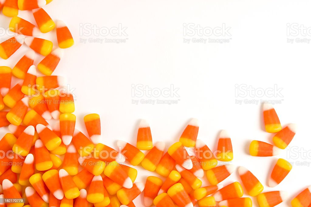 Orange and yellow candy corn set against a white background stock photo