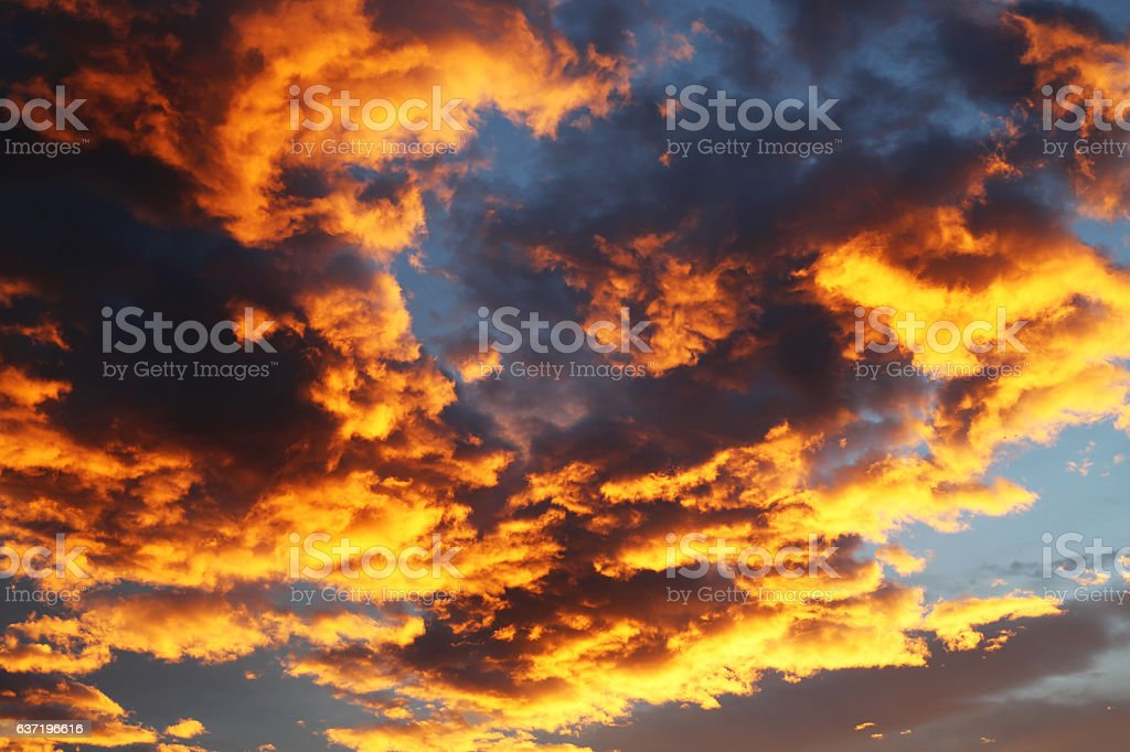 orange and yellow dramatic sky with clouds stock photo