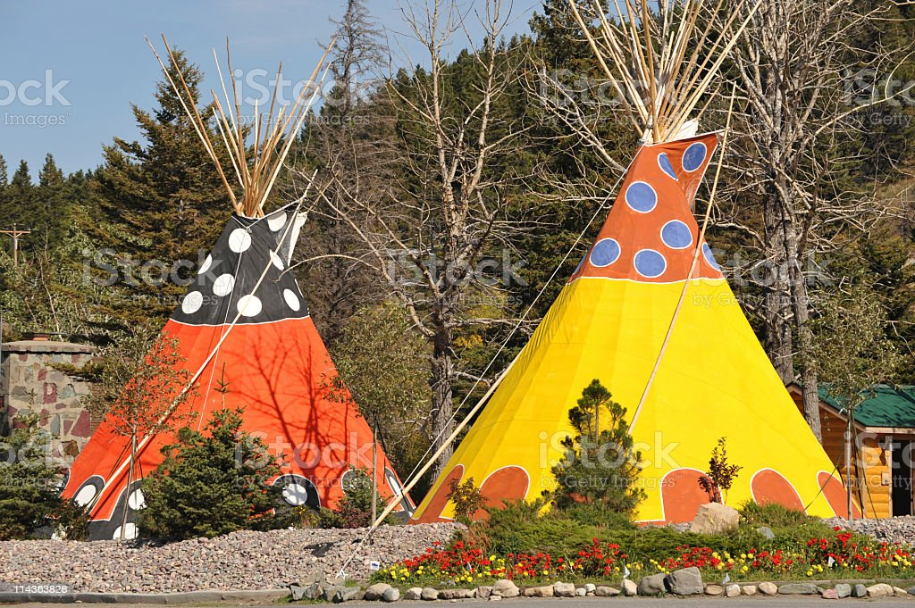 Orange and yellow  teepee lodging in Glacier National Park,USA stock photo