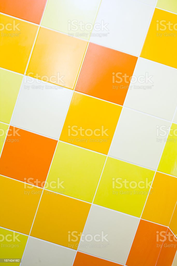 Orange and yellow tiled wall background royalty-free stock photo