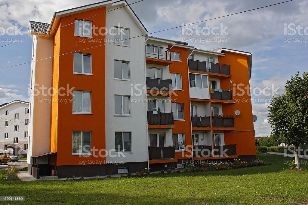 Orange apartment house on  grass stock photo