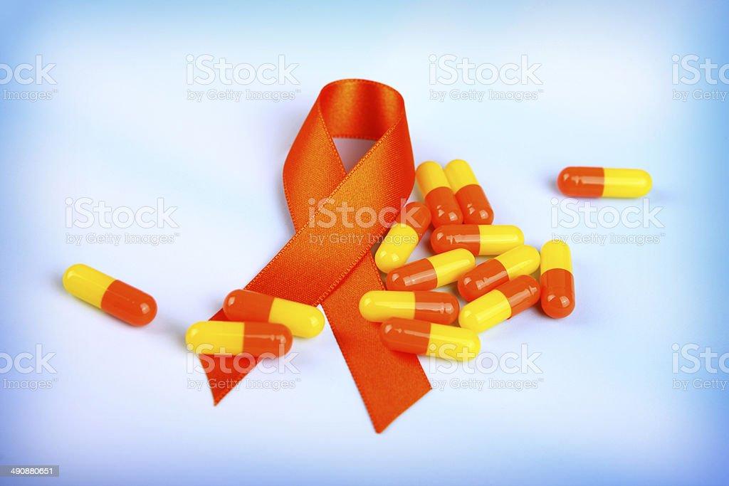 Orange Awareness Ribbon with Capsules stock photo