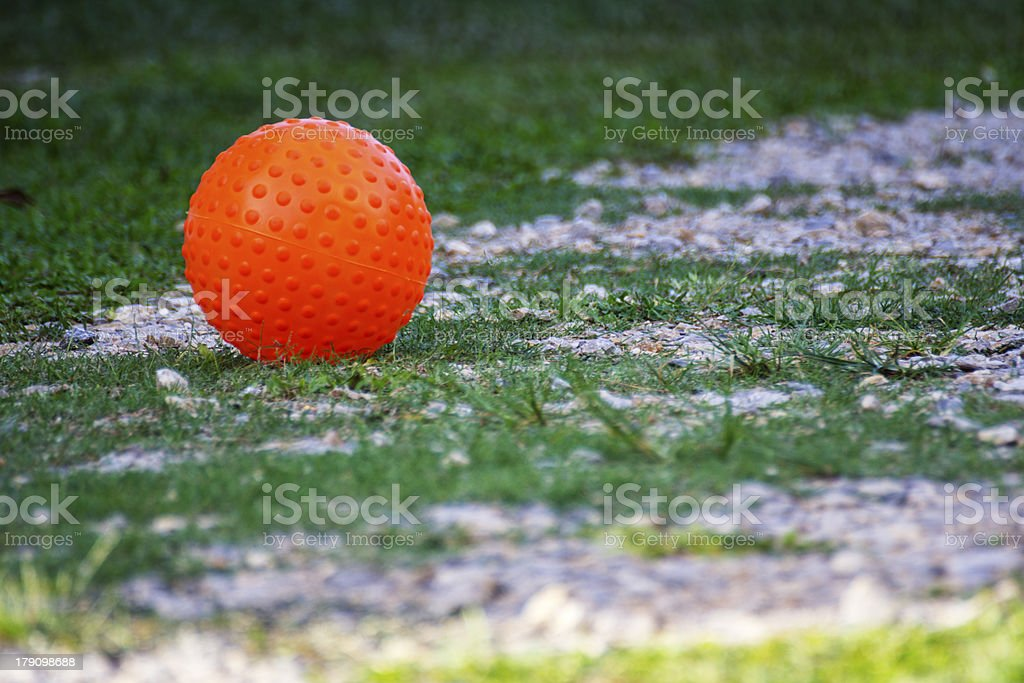 Orange ball on ground stock photo