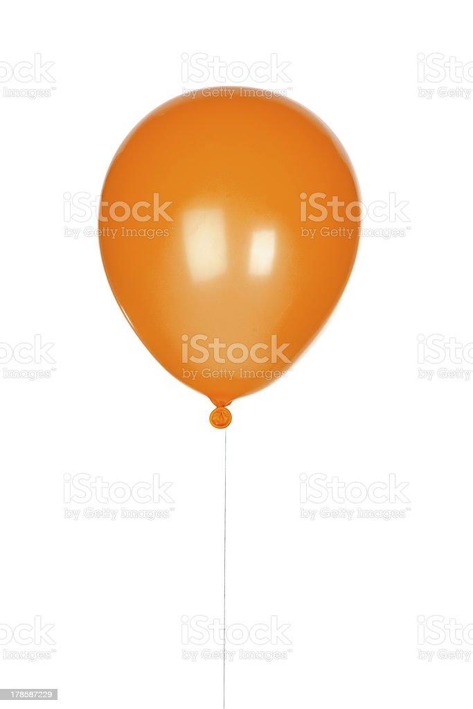 Orange balloon inflated stock photo