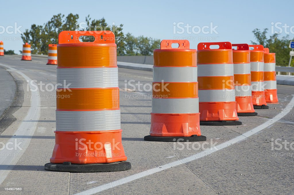 Orange barrels used in highway maintenance construction stock photo