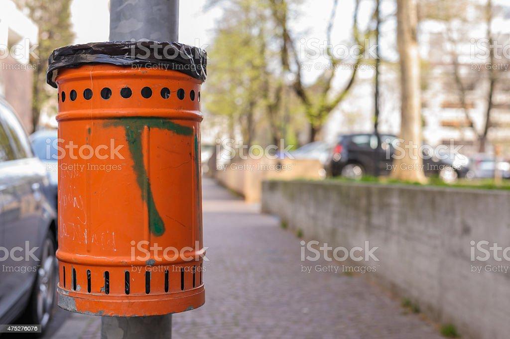 Orange basket for rubbish stock photo