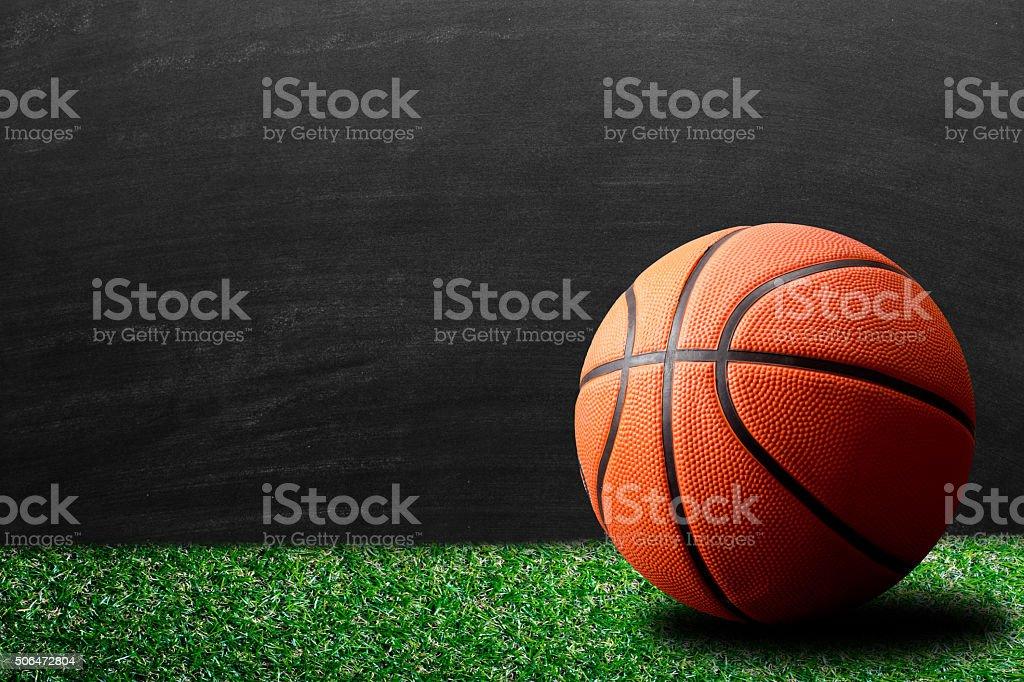 Orange basketball against blackboard stock photo