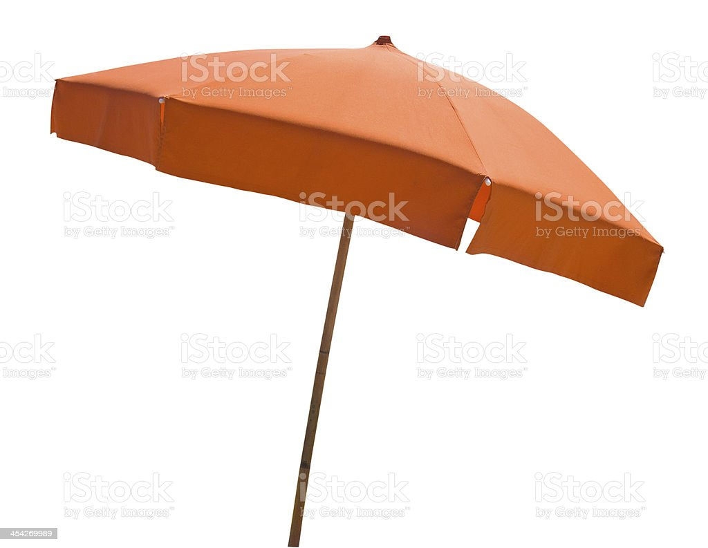 Orange beach umbrella isolated on white stock photo
