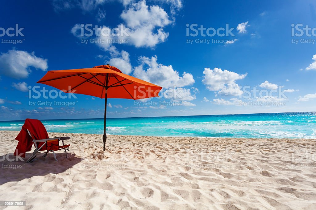 Orange beach umbrella stock photo