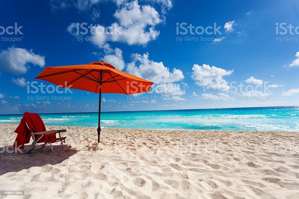 Orange beach umbrella stock photo