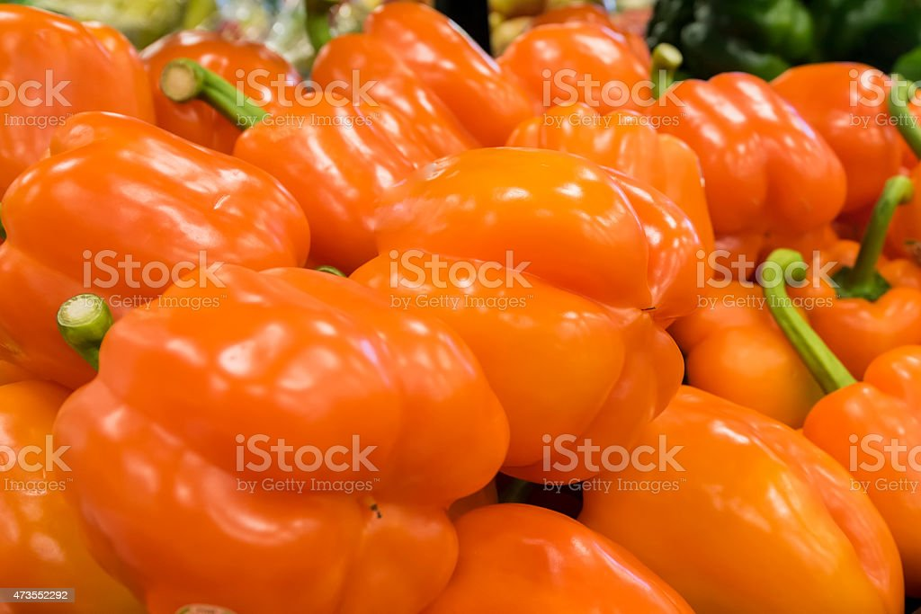 Orange bell Peppers in Supermarket stock photo