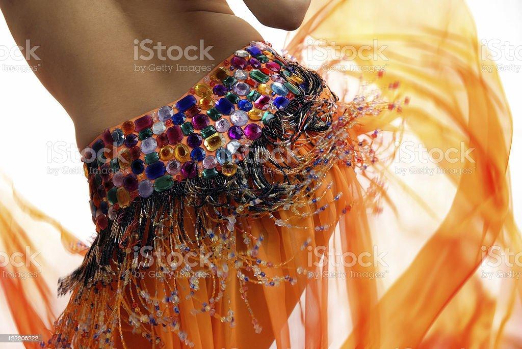 Orange belly dancer royalty-free stock photo