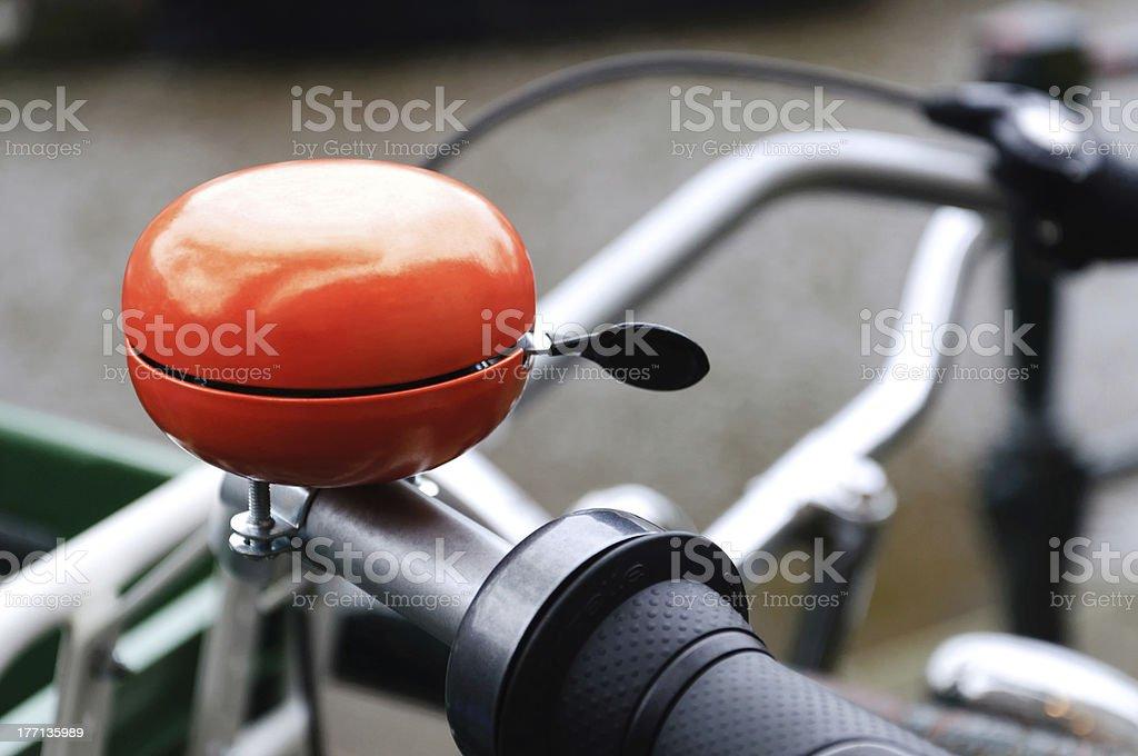 Orange bicycle bell stock photo