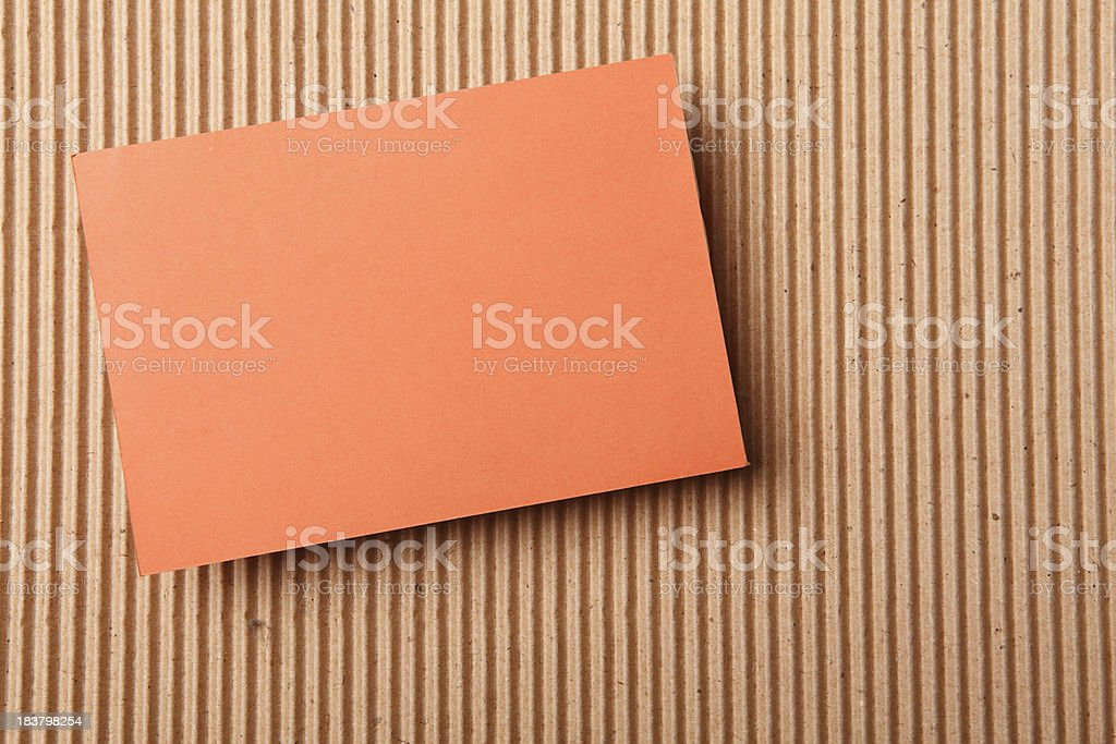 Orange blank cards lie on brown abstract paper XXXL royalty-free stock photo