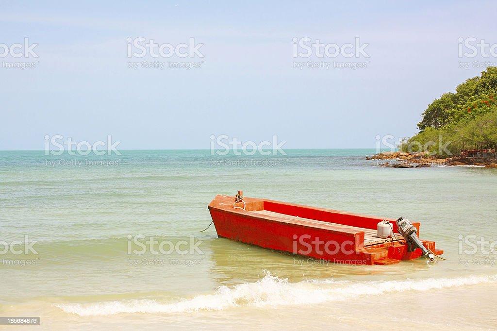 Orange boat at a beach stock photo