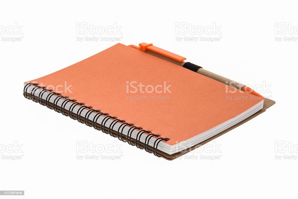 orange book and pen stock photo