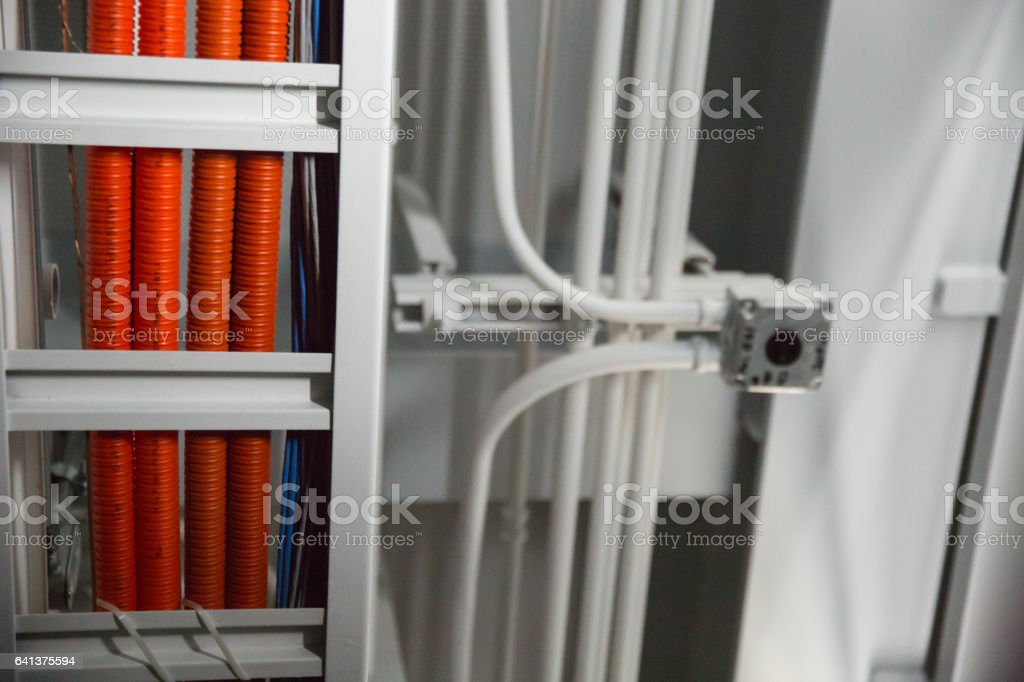 Orange Cables and Whites Pipes Running on Ceiling stock photo