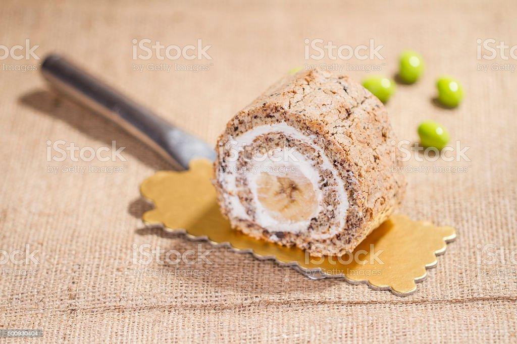 Orange Cake in gold dish on the straw sack table stock photo