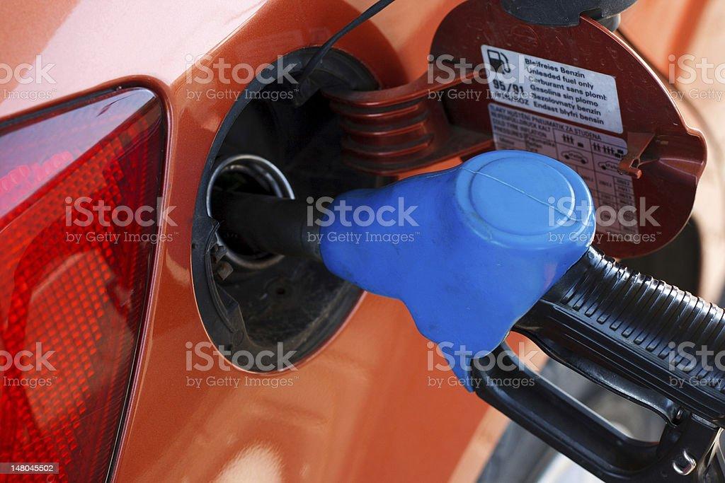 orange car at gas station stock photo