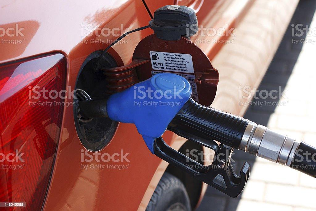 orange car at gas station royalty-free stock photo