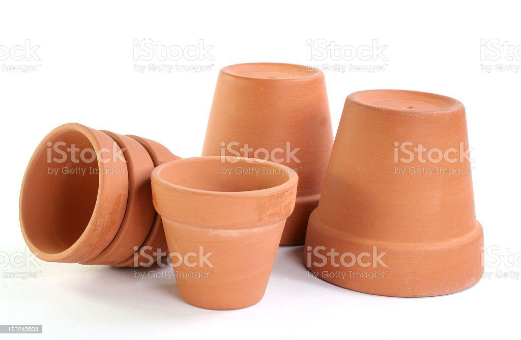 Orange ceramic garden pots against a white background stock photo