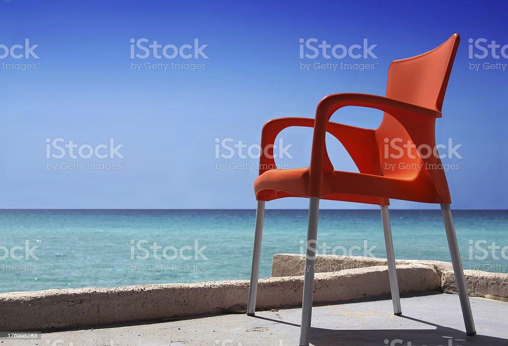 Orange Chair on Beach royalty-free stock photo