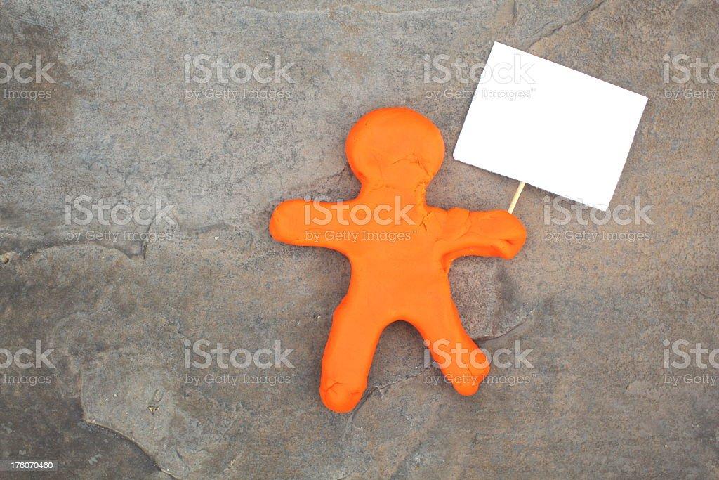 Orange Character Holding Blank Sign stock photo
