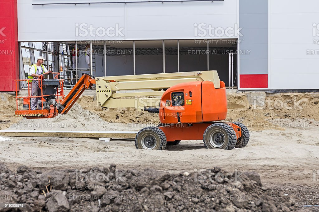 Orange cherry picker. Boom lift. stock photo