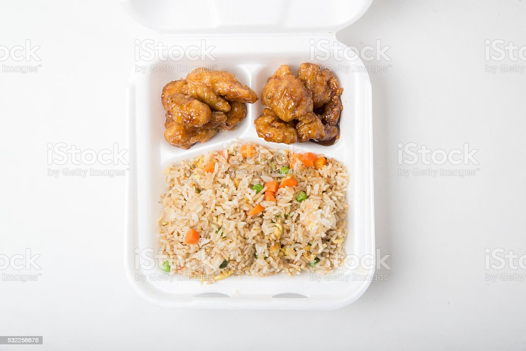 orange chicken and fried rice stock photo