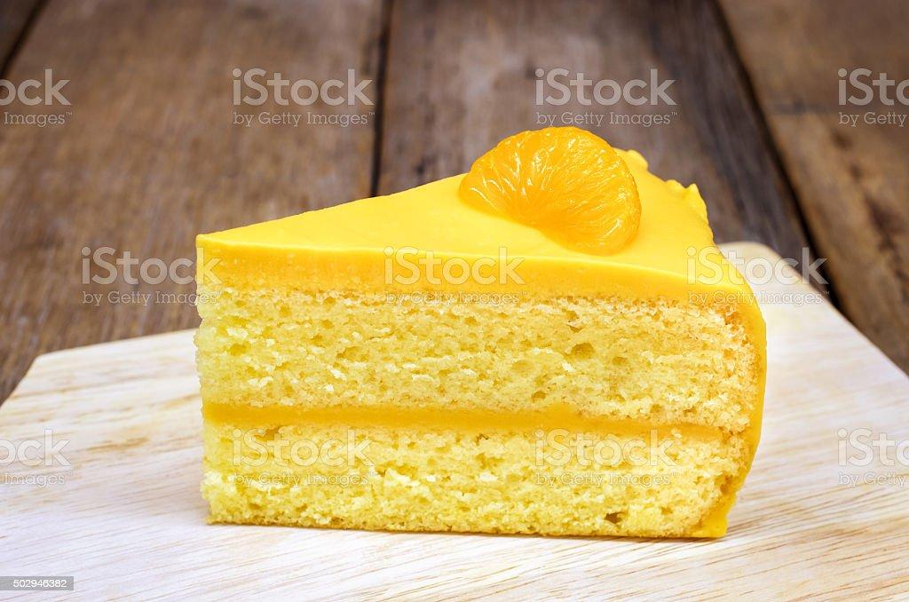 Orange chiffon cake on wooden background stock photo