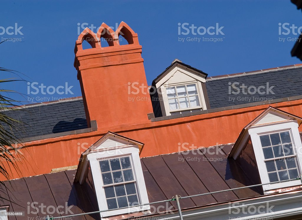 Orange Chimney and Roof Tilted royalty-free stock photo