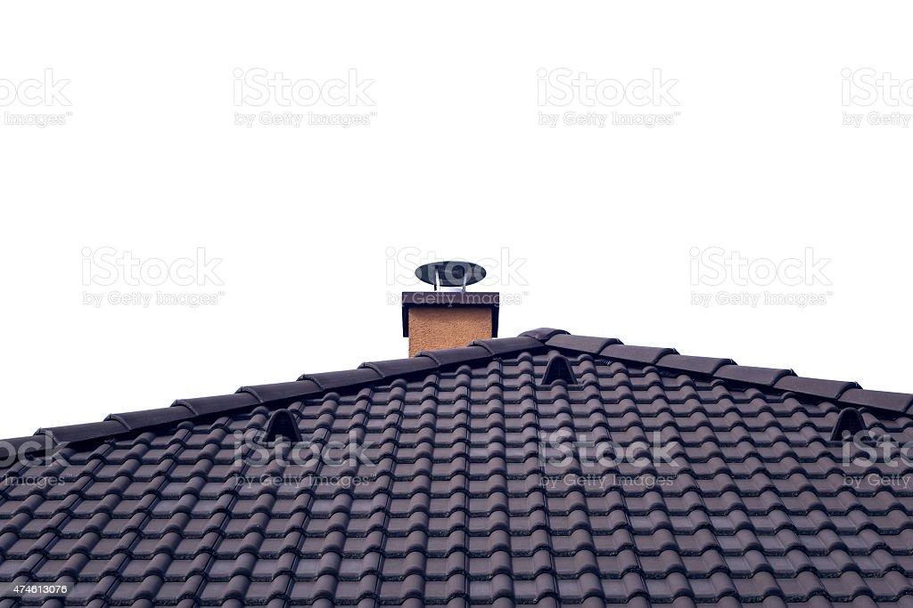 Orange chimney on tiled roof with isolated sky stock photo
