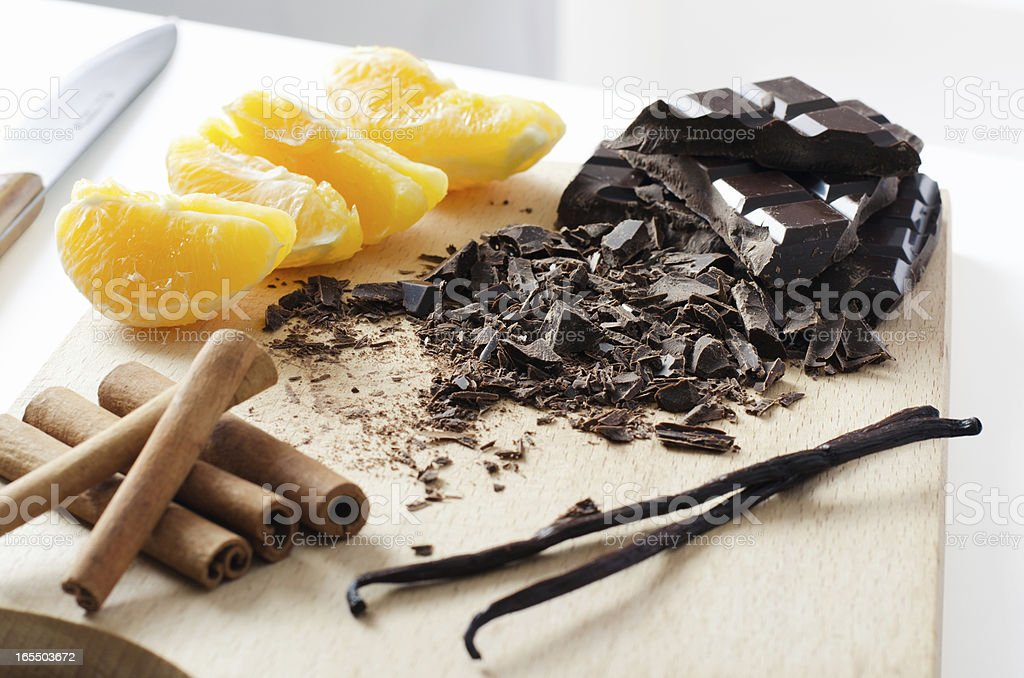 Orange chocolate vanilla and cinnamon prepared for dessert royalty-free stock photo