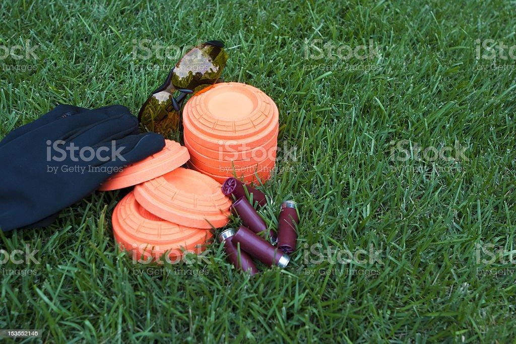 Orange clay skeet targets on green grass stock photo