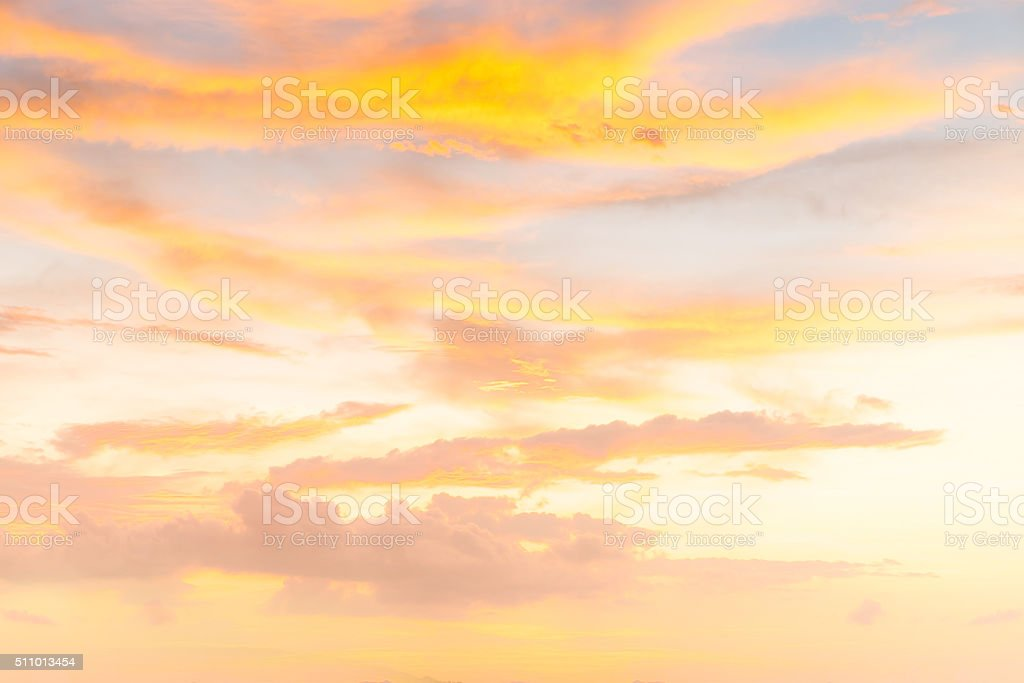 orange clouds at sunset background (soft focus) stock photo