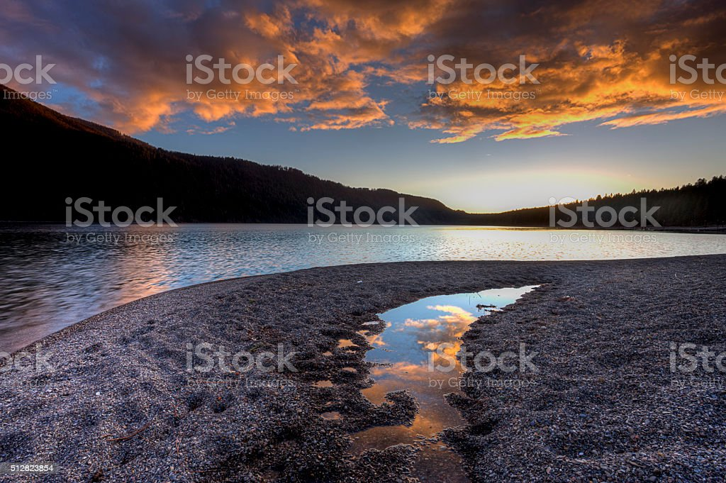 Orange clouds at sunset over the lake. stock photo
