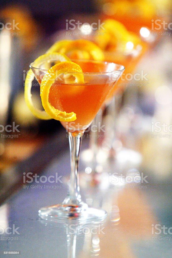 Orange cocktail drink with zest stock photo