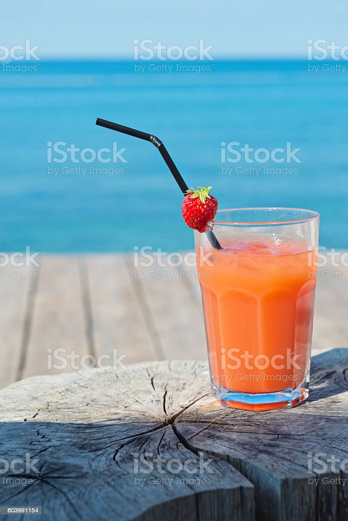 Orange cocktail on the wooden table stock photo