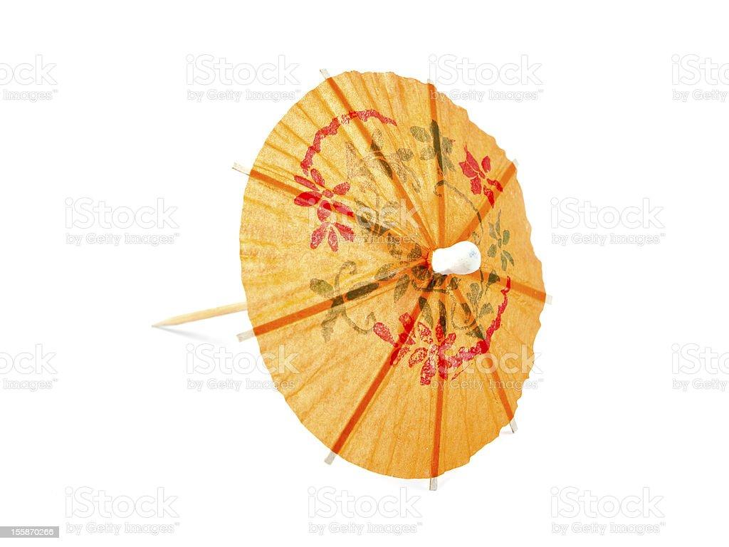 Orange cocktail umbrella royalty-free stock photo
