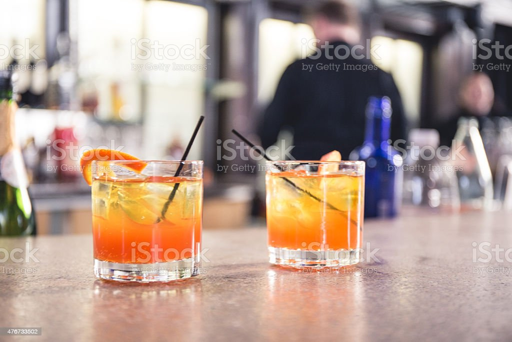 Orange cocktails on a bar stock photo