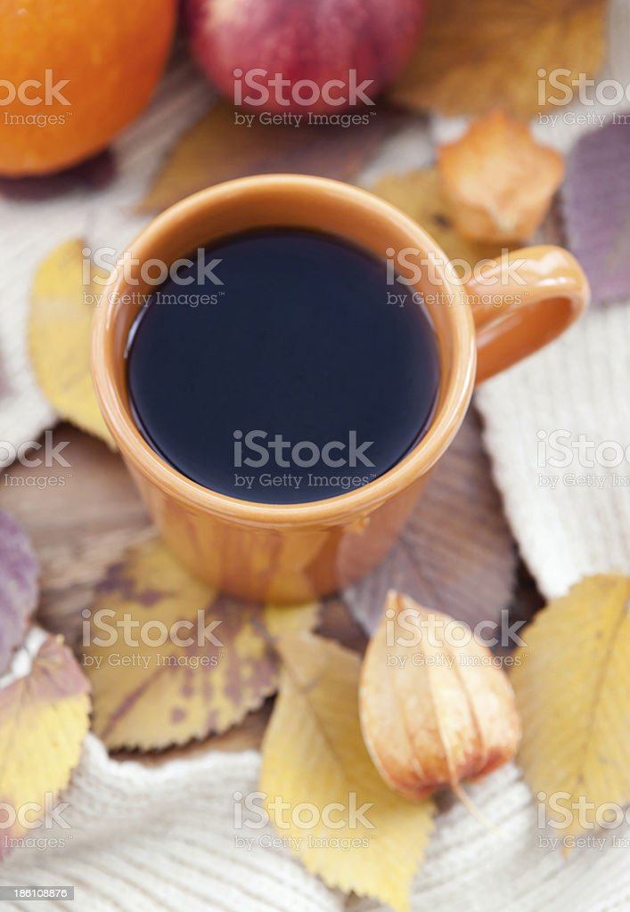 Orange coffee cup on the autumn fall leaves royalty-free stock photo