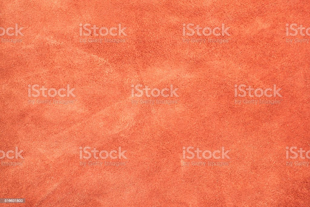 orange color crumpled suede leather texture background stock photo