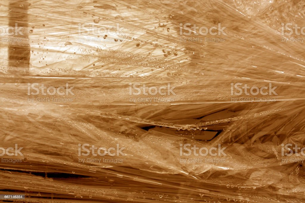 Orange color plastic wrap surface. stock photo