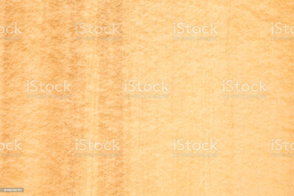 Orange colored desert varnish on sandstone cliff wall stock photo