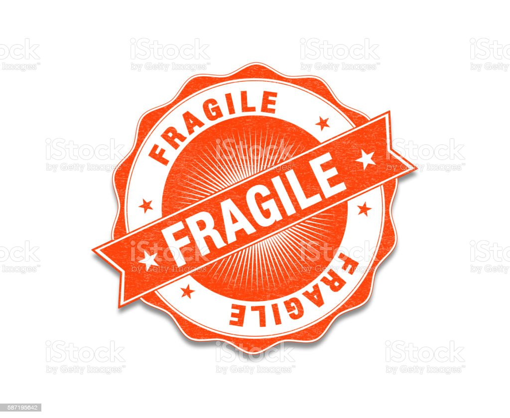 Orange Colored 'Fragile' Stamp On White stock photo