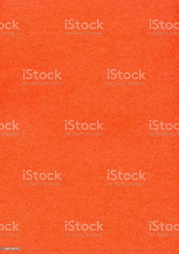 Orange construction paper textured background stock photo